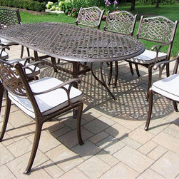 Oakland Living - 9-Pc Outdoor Oval Dining Set - Includes oval table and eight dining chairs with cushions. Metal hardware. Umbrella opening. Fade, chip and crack resistant. Warranty: One year limited. Made from rust free cast aluminum. Antique bronze hardened powder coat finish. Minimal assembly required. Chair: 22.5 in. W x 22 in. D x 35 in. H (23 lbs.). Table: 84 in. L x 42 in. W x 29 in. H (99 lbs.). Overall weight: 300 lbs.This dining set is the prefect piece for any outdoor dinner setting. Just the right size for any backyard or patio. We recommend that the products be covered to protect them when not in use. To preserve the beauty and finish of the metal products, we recommend applying an epoxy clear coat once a year. However, because of the nature of iron it will eventually rust when exposed to the elements. The Oakland Mississippi Collection combines southern style and modern designs giving you a rich addition to any outdoor setting. The traditional lattice pattern and scroll work is crisp and stylish. Each piece is hand cast and finished for the highest quality possible.
