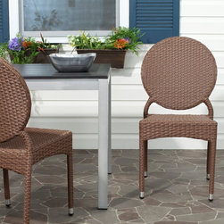 Safavieh - Safavieh Valdez Stackable Dining Side Chair - Set of 2 - FOX5204A-SET2 - Shop for Chairs and Sofas from Hayneedle.com! Modernist aesthetic isn't usually associated with wicker patio furniture or at least not successfully achieved in such efforts; but that's exactly the intersection at which lies the Safavieh Valdez Stackable Dining Side Chair - Set of 2. The cool clean-lined design of these intriguing outdoor side chairs is topped by a unique round backrest that creates a geometric balance reminiscent of a Maholy-Nagy composition - though much easier to sit on. Midcentury aesthetic aside these chairs are crafted with a completely contemporary construction. The aluminum and PE wicker materials guarantee a long life based on superior materials able to stand up to the elements.About SafaviehConsidered the authority on fine quality craftsmanship and style since their inception in 1914 Safavieh is most successful in the home furnishings industry thanks to their talent for combining high tech with high touch. For four generations the family behind the Safavieh brand has dedicated its talents and resources to providing uncompromising quality. They hold the durability beauty and artistry of their handmade rugs well-crafted furniture and decorative accents in the highest regard. That's why they focus their efforts on developing the highest quality products to suit the broadest range of budgets. Their mission is perpetuate the interior furnishings craft and lead with innovation while preserving centuries-old traditions in categories from antique reproductions to fashion-forward contemporary trends.