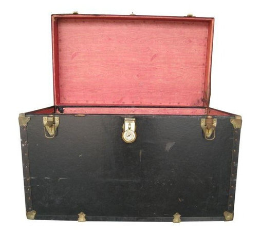 S&M Black Vintage Trunk - Solidly constructed black metal trunk with wooden interior. Age unknown but based upon items inside, seller estimates 1973.Would look great as a coffee table or at the foot of your bed! A smart choice for someone seeking a more economical opportunity to own a vintage trunk.