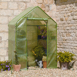 None - Compact Walk-in Greenhouse - The compact walk-in greenhouse is ideal for limited spaces with plenty of shelving for bountiful growth. This growhouse includes wall fixing rings and guy ropes.