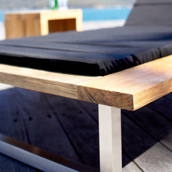 Outdoor Furniture Collection - Detail of Woolamai daybeds in black outdoor fabric with wire brushed teak and Stainless steel frames