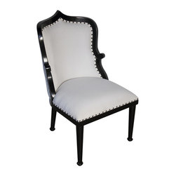 "Noir - Noir Cindra Chair - The Noir Cindra chair introduces classic regal style to transitional spaces. Atop tapered wood legs, a curved silhouette and nailhead trim offer the upholstered seat unforgettable design. 21""W x 25""D x 36""H; Hand-rubbed black mahogany; Finish will feature distressed characteristics; White cotton upholstery; Metallic nailhead trim"