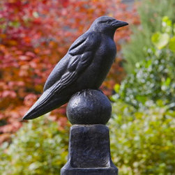 Raven Statue in Garden Ornaments - This raven statue reminds me of the Edgar Allen Poe room they have set up at UVA to memorialize his time there. This raven looks much better than the moth eaten one they have there - are you listening UVA? He is very serious, looks like he's either standing guard or ready to attack.