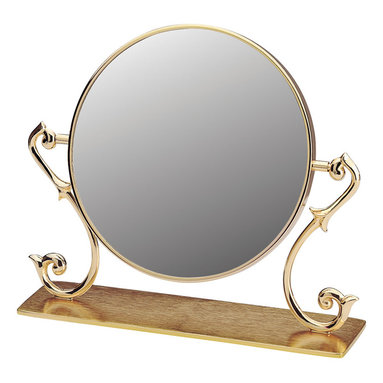 Renovators Supply - Mirrors Cast Brass Vanity Mirror Maginified Dbl-sided 9'' H | 19293 - Mirror. This swiveling double-sided vanity mirror offers a magnified view on its reverse side. Traditional in design yet modern in function it suits any decor. Made of cast brass it comes with a protective RSF finish. The magnified side has 1/2 in. brass rim surrounding the mirror. The normal side has a 1/8 in. brass rim surrounding the mirror. Overall it measures 9 in. H x 6 1/2 in. dia. The base plate is 10 1/4 in. W x 2 3/4 in. proj. and has a protective felt bottom.