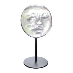 """Pre-owned Vintage Erik Hoglund Kosta Boda Face Sculpture - This is a very rare sculpture by Erik Hoglund (1932-1998) for Boda c. 1970 - a molded clear glass face with metal stand. It is in excellent condition with some wear to the base.     Erik Hoglund was design director for Boda Glassworks from the late 1950s until the early 1970s. Hoglund was one of the leaders of a revolution against the streamlined modernity of the 1950s, preferring to go back to arts and crafts roots. His work also coincided with the beginning of the Contemporary art glass movement here in the United States. Hoglund's works usually have """"handmade"""" detailing- with pressed glass, bubbles, ironwork, and a general notion of every piece being slightly unique despite being cataloged production."""