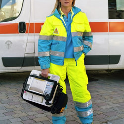 """Annalia, Misericordia Paramedic, Florence, Italy"" Artwork - Uniforms, outfits, & accessories we think of the word ""uniform"" to mean the distinctive clothing worn by members of the same organization. however, in today's society the term is somewhat distilled and can be used interchangeably to denote outfits that are similar in nature, but not exactly the same, and not necessarily worn by members of an organization. the history of the uniform, goes back to the history of clothing and textiles. textiles are defined as felt or spun fibers made into yarn that are netted, looped and knitted or woven into fabrics. they first appeared in the middle east during the late stone age. from these ancient times to the present day, the production of textiles evolved and influenced how people clothed themselves.  uniforms, and outfits, are a decisive part of the human physical appearance and this appearance has a social significance in all parts of the world. every society has a dress code that is well defined and understood by most members of that particular group. the dress code has specific rules, which in turn signal a message given by a person's clothing and the way it is worn. the message may indicate income, social class, religious affiliation, attitude, sexual orientation, marital status, or sexual availability. it may be seen in the clothes worn in the armed services, the paramilitary, the police, security guards, and the clergy. it can also be seen in shops, banks, post offices airports, bars, restaurants and hotels, sports teams, clubs, schools, and prisons. sometimes corporations use uniforms to create a brand or corporate image. (the first service uniform registered in the u.s. patent and trademark office was the playboy bunny outfit.). uniforms, and outfits in general, send social signals that usually indicate personal and cultural identity.  the idea of dress code works on many levels and is defined in many ways. one example..."