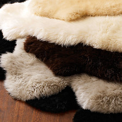 Horchow - Sheepskin Rug 2' x 3' - CHAMPAGNE - Sheepskin Rug 2' x 3'DetailsNatural sheepskin.Imported from New Zealand.Size is approximate.See our Rug Guide for tips on how to measure for a rug choosing weaves and patterns and more.Please note: Rugs (especially wool rugs) are prone to a natural shedding process. With regular vacuuming the shedding will decrease over time. Hand-knotted rugs tend to shed less than hand-tufted rugs and flatweave rugs will shed less than those with a deeper pile but all rugs will shed more in high-traffic areas than they do in lower-traffic spaces. Unfortunately we cannot provide rug swatches at this time. We apologize for the inconvenience.We recommend using a rug pad with every indoor rug to prolong its beauty by minimizing everyday wear and tear and providing a little breathing space to help prevent fiber damage. A pad also helps stabilize the rug reducing slippage on hard floors.