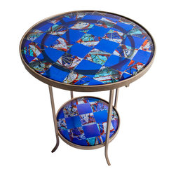 Art Glass Design Studio - Blue Art Glass Table - kiln-formed art glass table in blue and red. Steel faux painted base hold two glass shelves. Varda uses glass much like a quilter uses fabric; creating a glass canvas from bits and pieces of glass, that is fired, cut and used again in a new design, using layers of color and texture to create depth in a piece of art.
