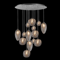 Oggetti - Cosmos 14 Light Pendant - Cosmos Pendant features three different shapes of spun Clear glass globes, hung at various heights from a Polished Stainless Steel canopy creating a unique display light. Available in 7 and 14 light options. 40 watt, 120 volt JC type G9 base halogen bulbs are included. UL listed. 7 Light: 10 inch width x 96 inch maximum height. 14 Light: 23 inch width x 96 inch maximum height.