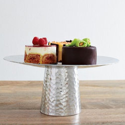 Hammered Metal Cake Stand - A cake stand may seem a little old fashioned, but this metal, hammered one from West Elm really gives this staple dishware a modern twist. The neutral palette makes it friendly for all types of entertaining.
