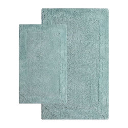 Chesapeake Merchandising - 2 Piece Napoli Bath Rug Set - 40110 - Shop for Mats and Rugs from Hayneedle.com! Step out of the shower and onto a tufted cloud of cotton. The contemporary 2 Piece Napoli Bath Rug Set has a non-slip backing to ensure a safe step and is available in a variety of pleasing colors to complement your decor. Set includes two matching rugs. Set Dimensions: Large rug: 24 x 40 inches Small rug: 21 x 34 inches About Chesapeake Merchandising Inc. Started in Maryland in 1995 Chesapeake Merchandising Inc. remains dedicated to producing quality textiles from the finest raw materials. Purveyors of fine rugs linens pillows and bedding they strive to stay abreast on the latest trends in the industry in order to provide their customers with the most up-to-date styles for their homes. Chesapeake employs dedicated workers with a passion for quality. Their facilities are located in both India and the United States; their permanent showroom is located in New York New York.