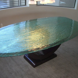 Creative Uses for Glass in Your Home - The color and texture of this glass table top adds so much interest to a room! With a translucent top the space becomes more lighted. -- Gravity Glas, Located in suite 120 of the SDC