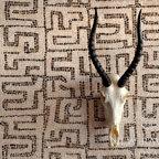 Kuba Stone Mosaic - Kuba, a hand chopped tumbled natural stone mosaic, is shown in Rosa Portagallo and Emperador Dark.