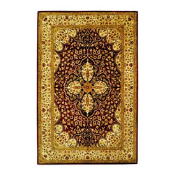 Safavieh - Red & Beige Rug with Center Design (2 ft. 6 in. x 12 ft. Runner) - Size: 2 ft. 6 in. x 12 ft. Runner. Hand Tufted. Made of Wool. Made in IndiaInspired by the legendary designs of Persia's most prestigious rug-weaving capitals, these extraordinary reproductions recreate some of the most prized antiques in Safavieh's archival collection. Intricate Tabriz, Lavar Kerman and Isfahan hand-knotted motifs are remarkably adapted to these hand-tufted rugs of incomparable quality. The finest New Zealand wool is chosen to achieve the intricate weave of these carpets. With utmost attention to every detail, Safavieh creates its Persian Legends Collection in India to provide consumers an exquisite yet affordable artisan-crafted look.