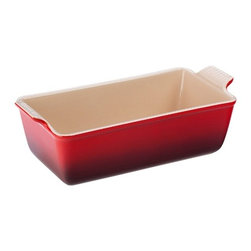 "Kitchen Supply - Le Creuset Heritage Loaf Pan - The Heritage Collection loaf pan is inspired by vintage designs from the early days of Le Creuset, with traditional styling and scalloped handlesPerfect for baking breads, meatloaf or cakes. Stoneware maintains even temperatures and prevents scorching. Unmatched thermal resistance"" safe for freezer, microwave, oven, broiler and dishwasher. Dense stoneware blocks moisture absorption to prevent cracking, crazing and rippling. Impermeable exterior enamel resists scrat and stains, and is safe for cutting on with knives. Nearly-Non Stick glazed interior easily releases foods for quick cleanup. Dimensions: 10"" L x 5"" W x 3.5"" high. . 5-year warranty."