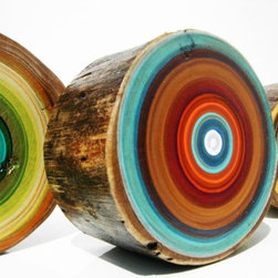 Original Tree Trunk Paintings by Focus Line Art - These small log slices are hand-painted in a swirling palette of amazing color combinations. I'd like several hanging on a wall together.