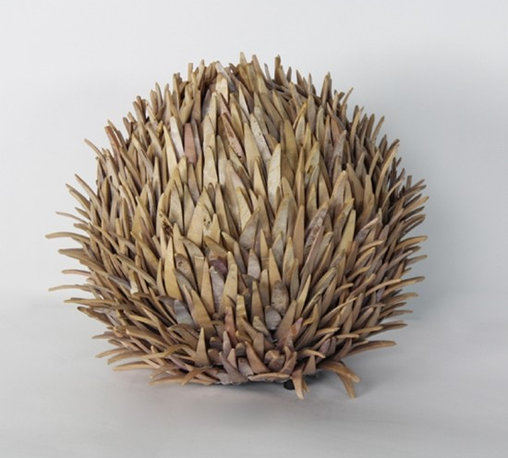 Small Sea Urchin Lamp - This hand-crafted table lamp was made to look like an urchin by precisely cutting small pieces of vinyl. The texture is amazing! It's way too pricey for me, but it does inspire my creative/DIY side.