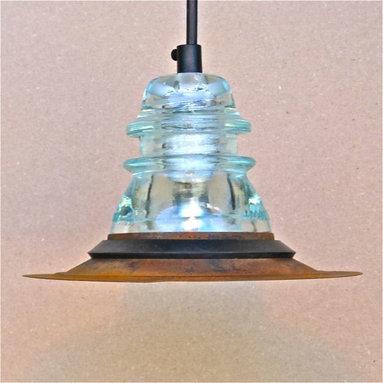 Insulator light with rusted steel hood -