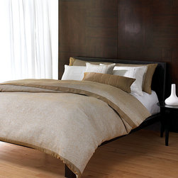 Jackson Bedding Collection - It may owe its luminous aesthetic to the sleek yet glamorous appointments of a tony metropolitan loft where literati gather amongst modernity and bonhomie. Spare and chic, the Jackson Bedding Collection boasts a neutral coloration of earthen beige, lustrous pearl, and gently glinting gold. The collection, which includes duvet cover, pillow shams, decorative pillows, and bedskirt, creates a restful ambiance in your master suite.