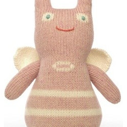 Zookie - This hand-knitted plush creature is a great way to add traditional pink to a girl's room without losing the eclectic individuality you're going for. Soft and fun to play with, this cutie even has knit eyes--so no small pieces. And she has the best smile.