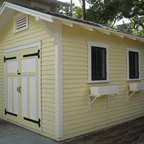 Craftsman Bungalow Shed in Tampa - A 10'x14' custom shed designed to complement a 1920s bungalow. The all wood shed has a gable roof with eave brackets, cypress siding, cypress bead board doors and salvaged wood windows with custom window boxes. Designed and built by Historic Shed custom outbuildings.