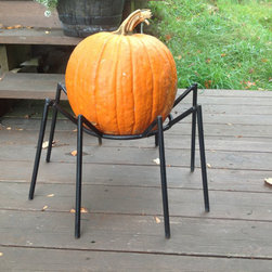 Halloween Spider Pumpkin Stand by Simply Snowman Designs - This is an easy way to turn your pumpkin into a spider — and keep your deck clean.