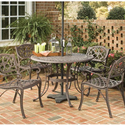 "Home Styles - 5 Piece Dining Set - Features: -With its intricately designed metal work, it will certainly become the focal point of the deck or patio.-Durable, lasting year after year.-Nylon glides on all table and chair legs.-Attractively patterned table top has center opening to accommodate umbrella.-Maintenance free.-Set includes one round dining table and four arm chairs.-Cast aluminum construction.-Non-toxic powder coated finish is hand antiqued and then sealed with a clear coat to protect the finish.-Umbrella not included.-Finish: Rust bronze.-Weather Resistant or Weatherproof: Weather resistant, but we recommend storing or covering for winter weathers.-UV Resistant: Yes.-Mildew Resistant: Yes.-Rust Resistant: Yes.-Glass Top: No.-Folding Table: No.-Folding Chairs: No.-Extendable: No.-Hardware Finish: Stainless steel hardware.-Stacking: No.-Chair Seat Material: Cast aluminum.-Chair Back Material: Cast aluminum.-Rocker: No.-Swivel: No.-Reclining: No.-Cushions: No.-Firepit Available: No.-Hardware Included: Yes.-Swatch Available: No.-Commercial Use: No.-Distressed: Yes.-Collection: Biscayne.-Eco-Friendly: No.-Product Care: Store covered when possible during harsh weather conditions. Wipe with cloth to clean..Dimensions: -Overall Table Height: 29"".-Overall Table Width - Side to Side (Table Size: 42""): 42"".-Overall Table Width - Side to Side (Table Size: 48""): 48"".-Overall Table Depth - Front to Back (Table Size: 42""): 42"".-Overall Table Depth - Front to Back (Table Size: 48""): 48"".-Overall Chair Height: 33"".-Overall Chair Width - Side to Side: 22.6"".-Overall Chair Depth - Front to Back: 22"".-Overall Chair Weight: 25 lbs.-Chair Arm Height: 24"".-Seat Height: 15.5"".-Umbrella Hole Diameter: 2"".Assembly: -Assembly required.Warranty: -Product Warranty: One year limited manufacturer warranty."