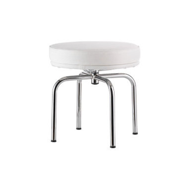 """Outdoor LC8 Swivel Stool - The LC8 Swivel Stool (1928) represents the designers' interest in exploring the structural possibilities of tubular steel and was designed to mirror the LC7 Swivel Chair. The LC Series was originally designed for indoor use, but after a visit to Villa Savoye, where some of the pieces were being used on the outdoor terrace, Cassina was inspired to create outdoor-safe models. The manufacturer spent 3 years working closely with the LC Foundation to develop a product that was within the foundation's parameters: To be """"the same or better quality than indoor."""" Cassina opted for better, using hand-polished AISI 304 stainless-steel with silver welding, as opposed to chrome, to construct the frames – a material with extreme resistance to corrosion that is actually more authentic to the product; chrome was not used until the 1970s/-80s. The silver welding will patina over time and develop a halo. Sunbrella® fabric covers the UV-resistant (and waterproof) seat cushion, which is wrapped in """"Ecofill"""" – a hypoallergenic fiber that dries quickly. Each piece is signed and numbered and, as a product of Cassina's Masters Collection, is manufactured by Cassina under exclusive worldwide license from the Le Corbusier Foundation. Made in Italy."""