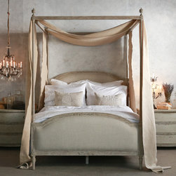 """Eloquence - Eloquence Dauphine Upholstered Beach House Natural Canopy Bed - The Eloquence collection of antique reproduction furnishings reflects the Old World glamour of classic European design. Constructed with an elegant four-poster canopy frame and handcarved finials and legs, the off-white Dauphine Beach House bed is beautifully hand-finished in Beach House natural. A romantic addition to a master or guest bedroom, this feminine bed's curved headboard and footboard are completed with fog linen upholstery. Available in queen and king sizes. Queen: 64""""W x 86""""D x 58""""H. King: 80""""W x 86""""D x 60""""H. 10 yards of fabric required to re-upholster."""