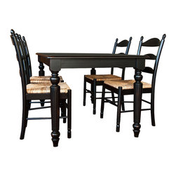 Carolina Cottage - 5 Pc. Dining Table & Vera Chairs Set in Antiq - Includes dining table and 4 chairs. Rectangular table can seat 5 - 6 people and features beautifully detailed turned legs. Beautiful 3 step hand finish with rubbed edges for a worn unique look. Made from 100% solid select Asian hardwood chairs. Comfortable rush seat. Easy to clean durable finish. Assembly required. Table: 60 in. W x 36 in. D x 30 in. H (90 lbs.). Chairs:. Seat dimensions: 16.5 in. W x 16 in. D x 18 in. H. Total: 17 in. W x 16 in. D x 38 in. H (16 lbs.)