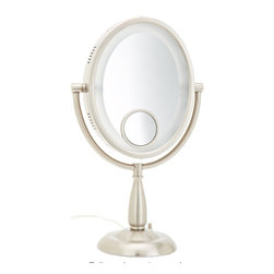 Jerdon HL9510N 8-Inch Two-Sided Oval Halo Lighted Vanity Mirror with 10x and 15x - The Jerdon HL9510N 8-Inch Two-Sided Oval Halo Lighted Vanity Mirror is a portable bathroom and makeup accessory that has multiple magnifications and lighting options to provide a great reflection whenever you need it. The fog free, two-sided oval mirror is 8-inches by 10-inches in size and features a smooth 360-degree swivel design that provides 1x and 10x magnification options to make sure every detail of your hair and makeup are in place. A spot mirror is also featured with 15x magnification. The halo light design around the perimeter of the mirror and smooth rotation provide a dynamic point of view. This item can use the JPT25W replacement bulb (sold separately). An on/off rotary knob will activate the power when you need it to provide low, medium or high light setting options. The HL9510N stands 17.5-inches high, stands upright on countertops, vanities and tables and has an attractive nickel finish that protects against moisture and condensation. The Jerdon HL9510N 8-Inch Two-Sided Oval Halo Lighted Vanity Mirror comes with a 1-year limited warranty that protects against any defects due to faulty material or workmanship. The Jerdon Style company has earned a reputation for excellence in the beauty industry with its broad range of quality cosmetic mirrors (including vanity, lighted and wall mount mirrors), hair dryers and other styling appliances. Since 1977, the Jerdon brand has been a leading provider to the finest homes, hotels, resorts, cruise ships and spas worldwide. The company continues to build its position in the market by both improving its existing line with the latest technology, developing new products and expanding its offerings to meet the growing needs of its customers.