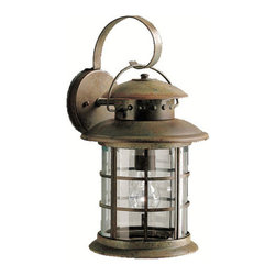 Kichler 1-Light Outdoor Fixture - Rustic Exterior - One Light Outdoor Fixture. If you are looking for a new interpretation of traditional design elements, the Rustic collection is for you. This outdoor lighting line captures the look and feel of a classic, aged lantern, yet updates it for modern homes. Our rustic finish over the solid brass frame offers you the high quality construction and materials with an affordable price Kichler is synonymous for. Clear beveled glass panels complete the Rustic collection's unique lantern look making it a fantastic value for almost any home. This one light, rustic wall lantern uses a 150-watt bulb and measures 17 high. It is UL listed for wet locations.