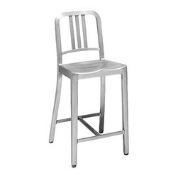 Emeco - 1006 Navy Counter Stool - Legend has it that Wilton Dinges, who founded Emeco in 1944, actually tossed a 1006 Navy Chair out the window of a six-story building. The result? A few minor scratches. Emeco's 77-step patented construction process was invented to satisfy a military need for lightweight, corrosion-resistant equipment. In the late 1990s, the Navy Chair's iconic design began catching the attention of architects and designers, initiating a new era for Emeco. Beginning with soft, recycled aluminum, 1006 Navy seating goes through a series of hand-crafted processes, including heat treatment and anodizing, to render the chair diamond-hard and virtually indestructible. Though imitations of the 1006 exist far and wide, Emeco's Navy Chair is the only one to go through this rigorous production process. Three small welds on the back of the slats are left exposed to indicate that this often-copied seating is the real thing. Specially made stainless steel foot caps are covered with a clear plastic glide to prevent scratching floors or snagging carpets. Optional seat pad available separately. Made in U.S.A.