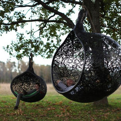 Manu Nest Hanging Chair - These handmade hanging chairs would be a unique addition to your yard. Bring a book and curl up in it, or swing away the day.