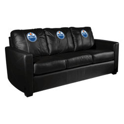 Dreamseat Inc. - Edmonton Oilers NHL Xcalibur Leather Sofa - Check out this incredible Sofa. It's the ultimate in modern styled home leather furniture, and it's one of the coolest things we've ever seen. This is unbelievably comfortable - once you're in it, you won't want to get up. Features a zip-in-zip-out logo panel embroidered with 70,000 stitches. Converts from a solid color to custom-logo furniture in seconds - perfect for a shared or multi-purpose room. Root for several teams? Simply swap the panels out when the seasons change. This is a true statement piece that is perfect for your Man Cave, Game Room, basement or garage.