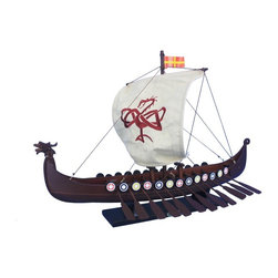 Handcrafted Nautical Decor - Viking Drakkar with Embroidered Serpent Limited 24'' - NOT A MODEL SHIP KIT--Attach Sail and the Drakkar Viking longship model is Ready for Immediate Display-- --Share the courageous spirit of adventure that made the  vikings the greatest explorers, traders and feared raiders of their age  with this replica Drakkar Viking with Embroidered Serpent longship model.--24'' Long x 15'' Wide x 16'' High------    Hand crafted by master artisans--    High quality woods used in construction--    Quality construction features:--    --        Lightly starched, quality       cloth sails do not sag or wrinkle--        Colorful shields lining gunwale--        --        Hand embroidered Serpent prominently displayed on sail--    --    --    Sturdy wooden base attached to longboat model--    --    Pre-assembled, simply attach the sails and      display--    --        Separate pre-assembled hull       and sails ensure safe shipping and lower cost--        Sails and rigging already       complete--        Insert mast in designated hole       and clip brass rigging hooks as shown in illustrations--        Ready to display in less than two minutes--    --    --