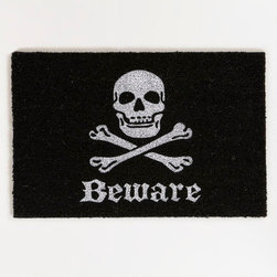 Skull and Bones Halloween Doormat - Doormats are easy and inexpensive to change up for the holidays. This black and white version is festive but still simple.