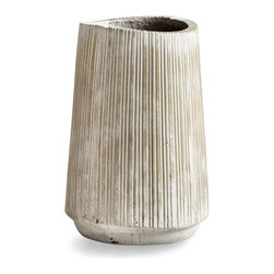 Calmont Planter - 10.75 X 10 - Raked with textured pinstripes, which are placed not quite evenly and travel from the base to the top of this slightly tapering vessel, the Calmont Planter is large enough to hold a smaller shrub and makes a striking sculptural vessel indoors and out.  Its sandstone finish is perfectly neutral, making it the ideal backdrop for organic displays of color and life.