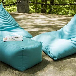 Jaxx Twist Outdoor Bean Bag Chair - This new beanbag shape takes the traditional square pillow and twists it up to create a super comfortable lounger chair. This unique, casual chair is durable enough for fun on the patio or by the pool, while being stylish enough for your living room. The Jaxx Twist Outdoor Bean Bag Chair is covered in a bright, woven polyester fabric. This special fabric is UV protected to resist fading, keeping your bright colors vibrant.