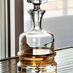 Traditional Decanter - Clear - A wide, substantial base and a horizontal band of heavy glass emphasize the width of the Traditional Decanter, while its tapering neck and blocky glass stopper provide perfectly-kept spirits to you and your guests. Also superb for an unusual presentation of drinking water or juices, this clear glass decanter suggests an inherited quality amidst your barware.