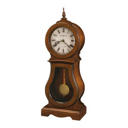 HOWARD MILLER - Howard Miller Cleo Triple Chime Pendulum Mantel Clock - This traditional wooden mantel clock features a turned finial and seeded glass in the lower door.