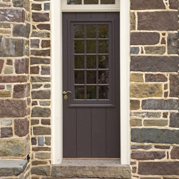 Exterior Door with Large Window Sash - This is a traditional sheathed door with a fifteen lite sash.  The door is fitted into a deep door frame with a transom lite above.