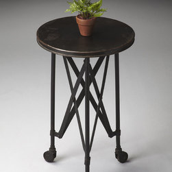 None - Black Industrial Side Table - Crafted from iron on iron casters, this aged, industrial-look accent table evokes the charm of a by-gone era. It features a distinctive interlaced base linking legs and tabletop.
