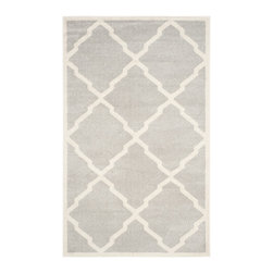 Safavieh - Capri Indoor/Outdoor Rug, Light Grey / Beige 5' X 8' - Construction Method: Power Loomed. Country of Origin: Turkey. Care Instructions: Easy To Clean. Just Rinse With A Garden Hose. Coordinate indoor and outdoor living spaces with fashion-right Amherst all-weather rugs by Safavieh. Power loomed of long-wearing polypropylene, beautiful cut pile Amherst rugs stand up to tough outdoor conditions with the aesthetics of indoor rugs.