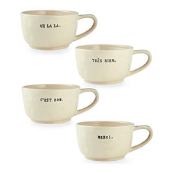 Cafe Au Lait Mugs, Set of 4 - Superb for soup as well as for the perfect expression of after-dinner coffee, the Set of Four Cafe au Lait Mugs feel casual and welcoming, and their French phrases will bring a little smile every time you get them out of the cupboard for a dinner party or a lazy afternoon on your own. Set a sophisticated mood of enjoyment with these black and white ceramic mugs.