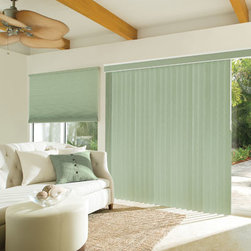 Levolor Custom S-Curve Vertical Blinds - Levolor Vertical Blinds are ideal for patio doors and large windows. Available in vinyl, vinyl embossed, and fabric laminate vinyl vane styles, and feature S-shaped slats for tighter closure. An anodized aluminum LXT2000 headrail with self-lubricating tracks and Delrin vane stems make this headrail long-lasting and durable.