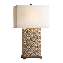 Uttermost - Curino Golden Bronze Table Lamp - Relief detail finished in a golden bronze stain with silver champagne accents and rustic black details. The rectangle box shade is a silken golden champagne fabric. Light bulb not included. Lighting specs included in packaging.