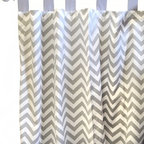 "New Arrivals Inc. - Gray Chevron Zig Zag Curtain Panels - The Gray Chevron Zig Zag Curtain Panels by New Arrivals, Inc. measure 52"" x 84"". With the tabs, the panels are 88"" long. The Gray Chevron Zig Zag Curtain Panels are sold as a Set of 2."