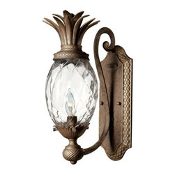 Hinkley Lighting - Plantation Wall Sconce No. 4140 by Hinkley Lighting - A tropical delight, filled with transitional appeal and a unique pineapple shape. The Hinkley Lighting Plantation Wall Sconce No. 4140 features a beautiful clear optic glass shade with metal foliage accents, stamped detailing and a flourished support. A nice choice for today's distinctive decors and spaces--kitchens, living rooms, bedrooms, sunrooms and more. Also complements the rest of the Hinkley Plantation lighting collection, including the pineapple-themed pendants and chandeliers. Cleveland-based Hinkley Lighting is driven by a passion to combine design and function to create exceptional lighting solutions. Family-owned Hinkley began as a traditional lantern company in 1922, and, still today, they produce top quality outdoor lighting. Hinkley Lighting has also expanded to include a full range of interior lighting solutions, including chandeliers, sconces, pendants and vanity lights.