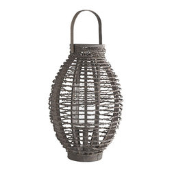 Oval Rattan Hanging Candleholder | Wisteria - As you start planning for your outdoor space during these cold months, think about how smashing these rattan lanterns will look when they are illuminating your space at night. During the winter days, enjoy them around the house on your dining room buffet and table.